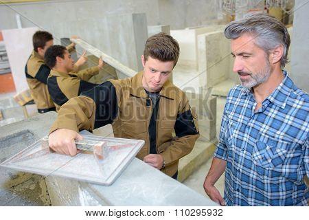 Apprentice flattening off cement