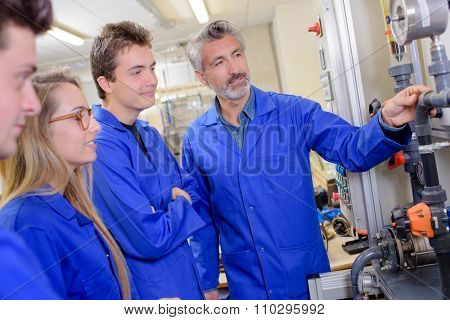 Tutor explaining pipework to students