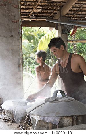Men producing rice papers