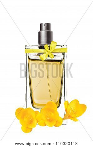Women's Perfume In Beautiful Bottle And Freesia Flower Isolated On White