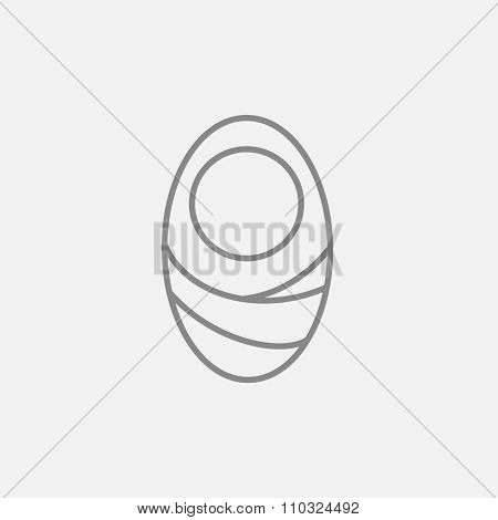 Infant wrapped in swaddling clothes line icon for web, mobile and infographics. Vector dark grey icon isolated on light grey background.