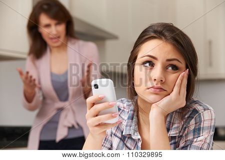 Mother Arguing With Daughter Over Use Of Mobile Phone