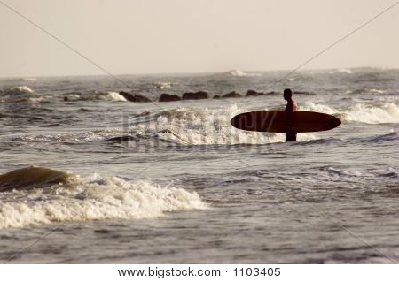 stock photo of a surfer on tybee island beach poster