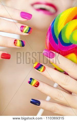Rainbow manicure .