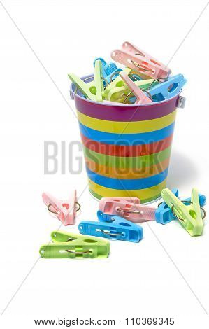 Color Clothes-pegs In Colorful Pot