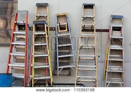 Ladders hanging from a wall
