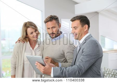 Realtor presenting new apartment to clients