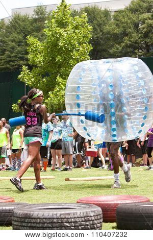 Man Wearing Plastic Ball Runs Bubble Gauntlet At Atlanta Event