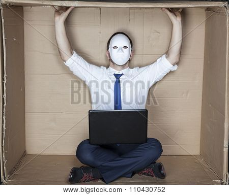 Businessman In A Mask Sitting In An Empty Office