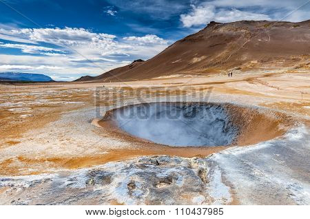 Hverarond is a geothermal field in Krafla caldera area near Mvatmn Lake which is full of mudpots steam vents sulphur deposits boiling springs and fumaroles. A mudpot -- or mud pool -- is a sort of acidic hot spring or fumarole with limited water. poster