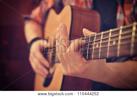 Guitarist Playing On Guitar
