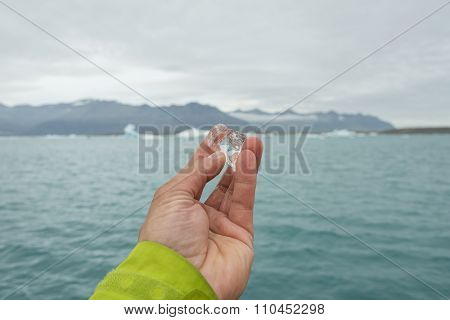 Peice Of Melting Glacier Ice In Man's Hand On Iceland, Summer Time
