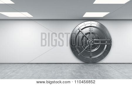 A Big Locked Round Metal Safe In A Bank Depository