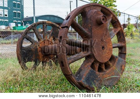 Abandoned Wheels From And Steam Powered Locomotive.