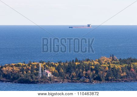 Great Lakes Oar Boat Passing Behind A Lighthouse
