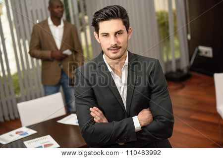 Cheerful Young Businessman In Formalwear Keeping Arms Crossed