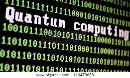 Computer screen with quantum computing logo with a binary computer code