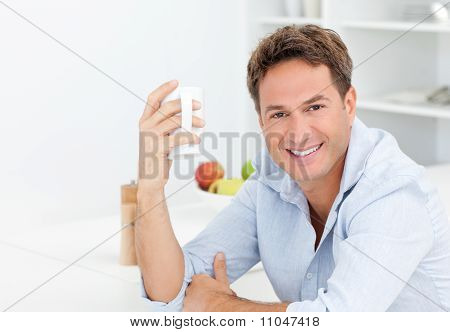 Happy Man Enjoying His Coffee During A Break