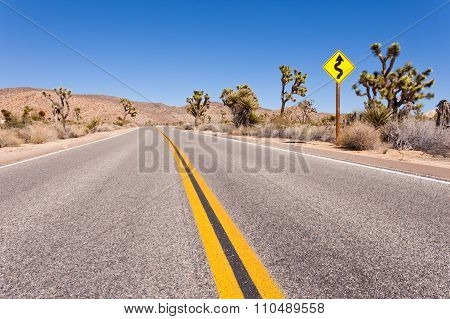 Winding road in Mojave Desert of Joshua Tree National Park California USA
