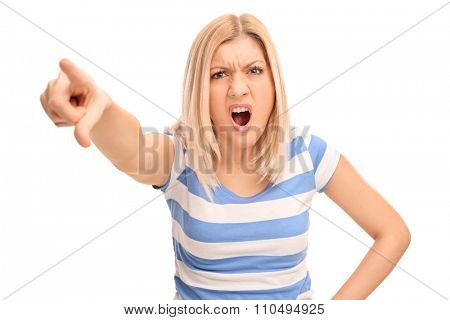 Angry blond woman scolding someone and pointing with her finger towards the camera isolated on white background
