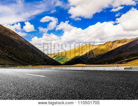 curved mountain highway against cloudy sky,landscape background.