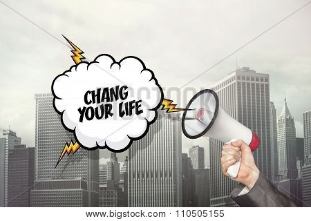Change your life text on speech bubble and businessman hand holding megaphone