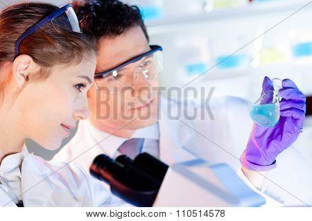 Researcher observing indikator colour shift.