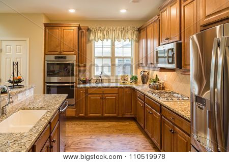 Kitchen With Granite Stainless And Hardwood