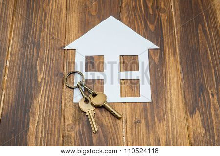 House With Key On Wooden Background, New House