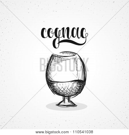 Monochrome cognac in glass with calligraphy. Sketch by hand