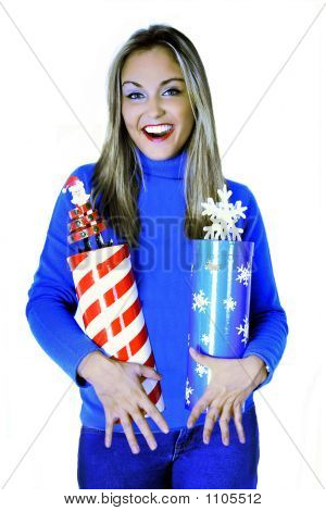 Young Lady Or Girl Or Woman Holding Two Christmas Gift Boxes