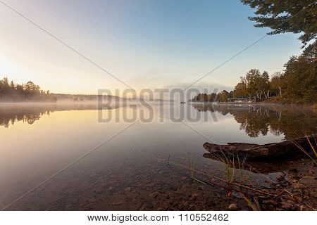 foggy morning in the lake of  Algonquin Provincial Park, Ontario, Canada
