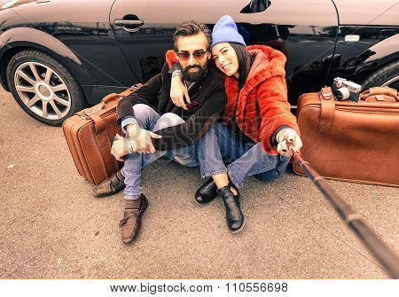Hipster Couple Making A Selfie With Stick  - Travel And Fashion Lifestyle Concept