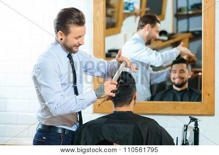 Professional barber  making haircut
