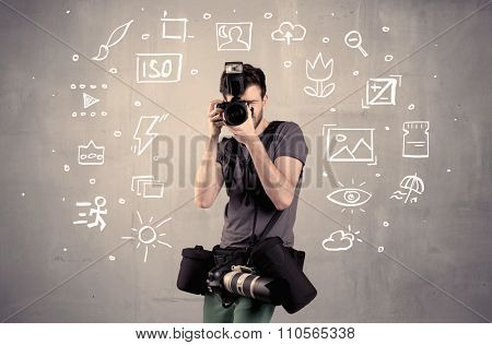 An amateur hobby photographer learning to use a professional digital camera with camera settings icons on the background wall concept poster