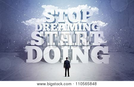 A lazy sales person standing in emty space with huge block letters illustration saying stop dreaming start doing and clouds concept poster