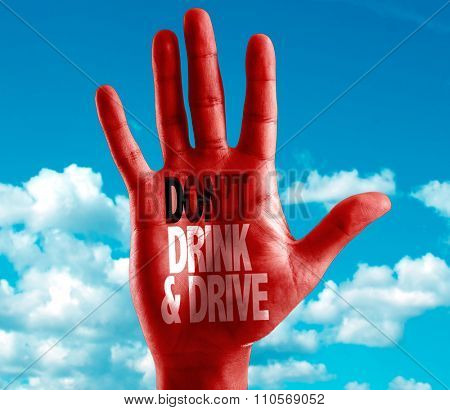 Don't Drink and Drive written on hand with sky background