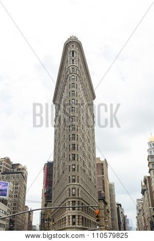 NEW YORK CITY, UNITED STATES - JUNE 20, 2015: The Flatiron Building, originally the Fuller Building, is a triangular 22-story steel-framed landmarked building located at 175 Fifth Avenue in the borough of Manhattan, New York City, and is considered to be