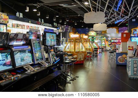 SHENZHEN, CHINA - MAY 25, 2015: interior of game zone in COCO Park shopping center. COCO Park in Longgang District is a popular shopping, dining and leisure destination