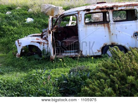 old car left to rot as junk in a field poster
