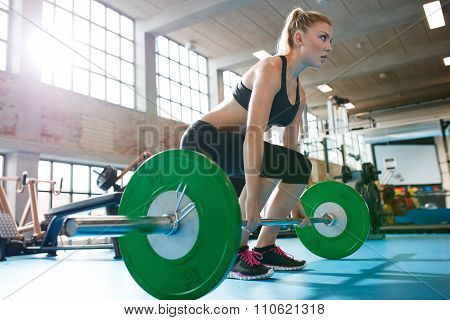 Woman In A Gym Doing Heavy Weight Exercises