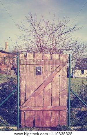 Vintage Toned Wooden Gate With Beware Of Dog Sign