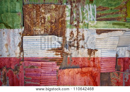 An abstract background image of the flag of Somaliland painted on to rusty corrugated iron sheets overlapping to form a wall or fence. poster