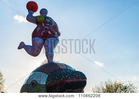 HAMBURG, GERMANY - May 1, 2013: Panorama view Hamburg port with Nana Sculpture..  Plastic of famous artist Niki de Saint Phalle one of two sculptures situated in front of Theatre in Port
