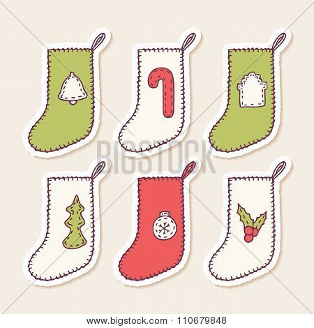 Set of hand drawn christmas sock stickers with different sewn decorations for your design. Doodle ho