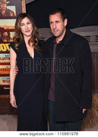 LOS ANGELES - NOV 30:  Adam Sandler & Jackie Sandler arrives to the