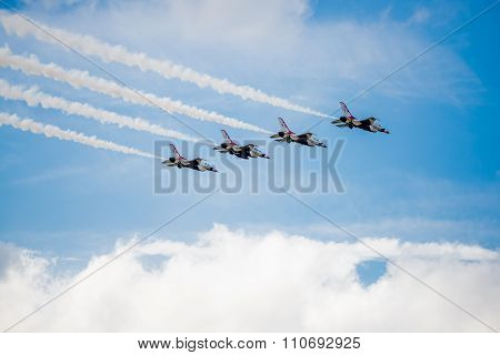 Usaf Thunderbirds Flying Over The Clouds