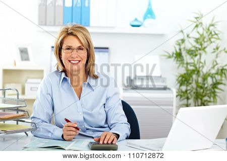 Beautiful mature business woman working in modern office.