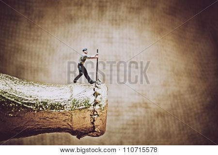 Miniature Worker Opening A Beer Bottle. Color Tone Tuned Photo