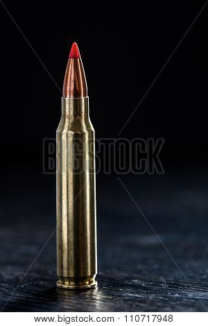 Small-caliber tracer cartridges on a dark background